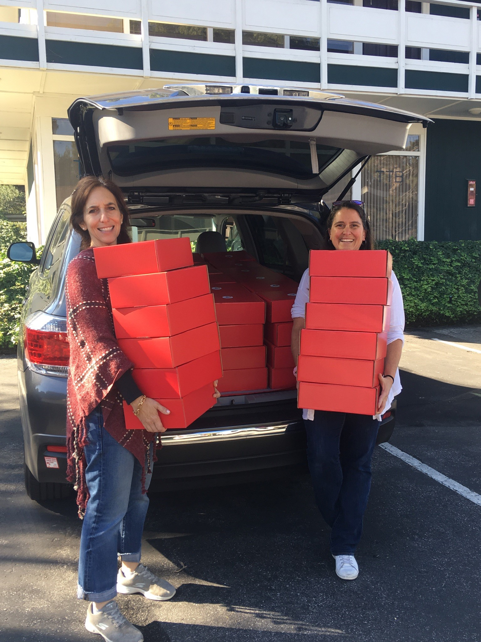 First delivery on its way by Founder and President Lauren Dennis-Perelmuter [left] and Volunteer Director [right] for Art To Grow On's Holiday Art Box Campaign