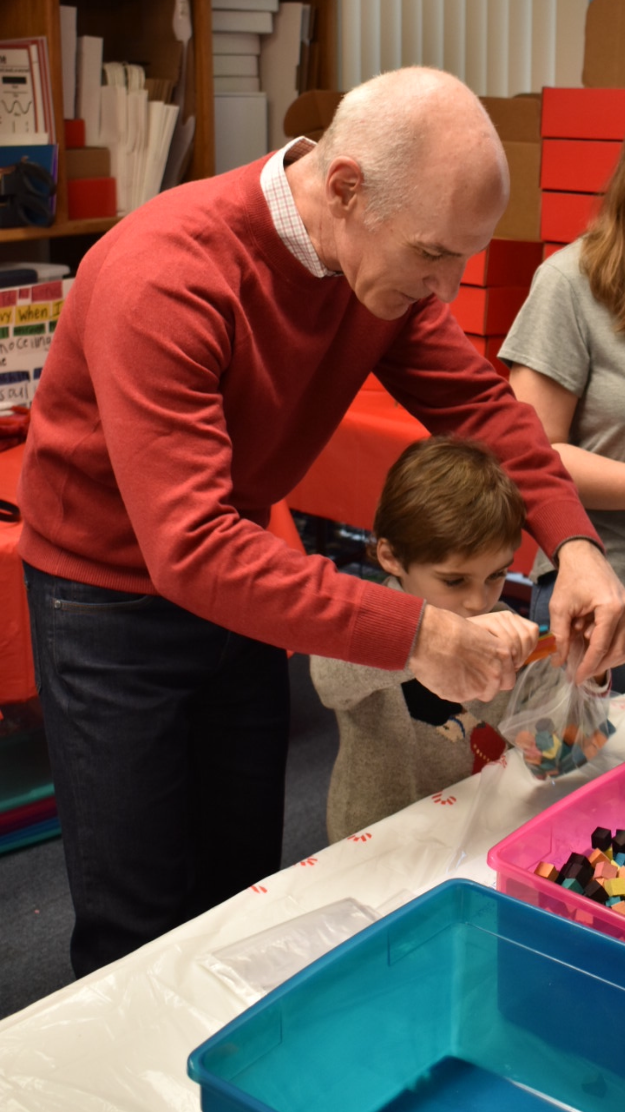 Dominic Iannitti, CEO of DocMagic, and his son Dominic Jr., helping with the Art Box project