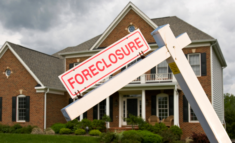 Foreclosure filings were reported on 104,111 properties last month, according to new data from RealtyTrac