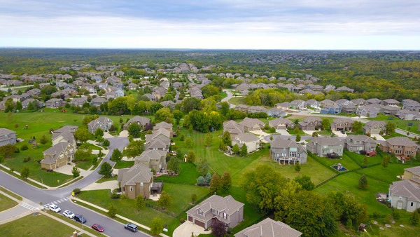 Aerial photo of homes in a suburban neighborhood.